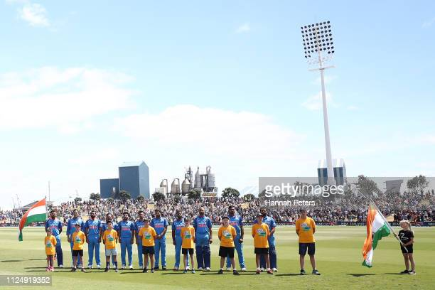 The Indian team sing the national anthem ahead of game two of the One Day International Series between New Zealand and India at Bay Oval on January...