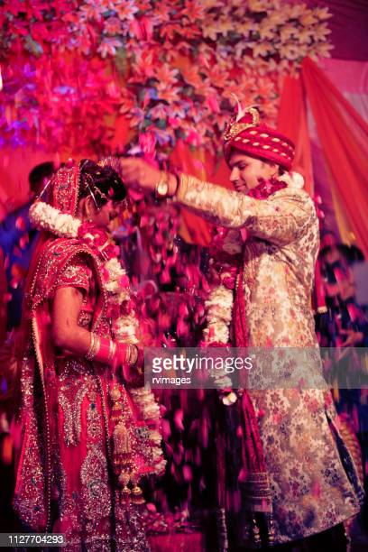 the indian wedding garlands or jaimala ceremony - vertical stock pictures, royalty-free photos & images