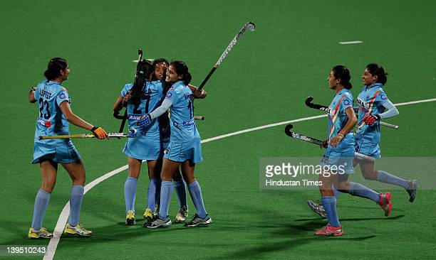 The Indian women's hockey team captain Asunta Lakra is congratulated by teammates after scoring goal against South Africa during the women's field...