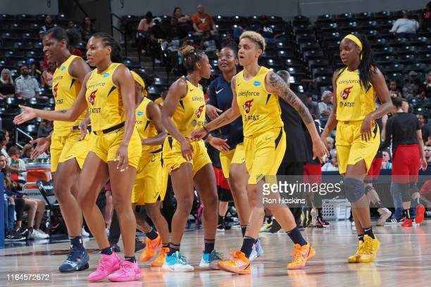 The Indiana Fever celebrate during the game against the Las Vegas Aces on August 27, 2019 at the Bankers Life Fieldhouse in Indianapolis, Indiana....