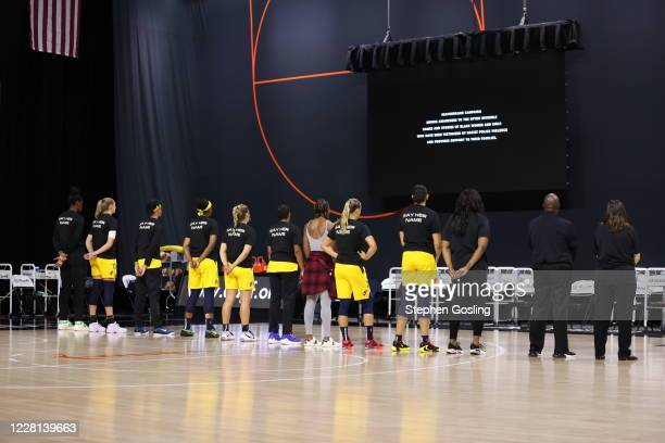 The Indiana Fever stand during a 26 second moment of silence in honor of the Say Her Name Campaign on August 20, 2020 at Feld Entertainment Center in...