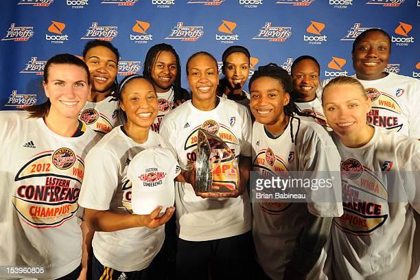 The Indiana Fever team poses for a photo Back Row Eriana Larkins Sasha Goodlett Tammy SuttonBrown Karima Christmas Jessica Davenport Front Row...