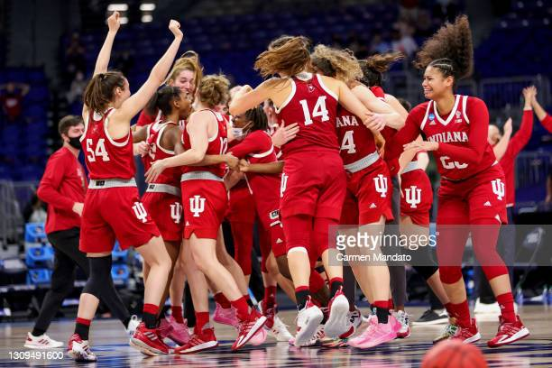 The Indiana Hoosiers celebrate defeating the NC State Wolfpack 73-70 in the Sweet Sixteen round of the NCAA Women's Basketball Tournament at the...
