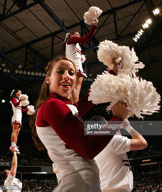 The Indiana Hoosiers cheerleaders perform before the round two game of the NCAA Men's Basketball Tournament against the UCLA Bruins at Arco Arena on...