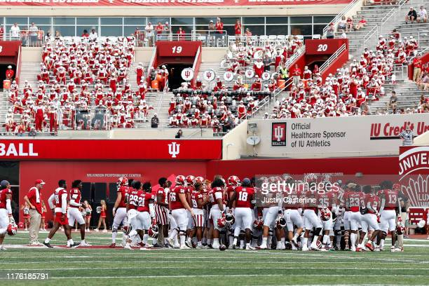 The Indiana Hoosiers run onto the field in support of Coy Cronk of the Indiana Hoosiers in the game against the Connecticut Huskies at Memorial...