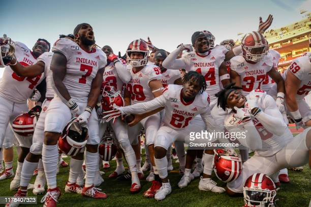 The Indiana Hoosiers team celebrates in front of their fans after the win against the Nebraska Cornhuskers at Memorial Stadium on October 26 2019 in...