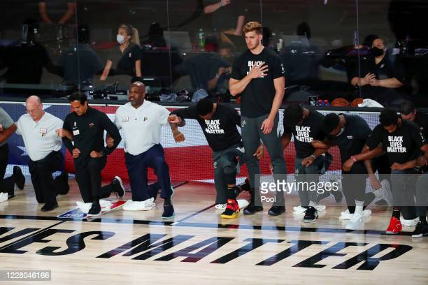 The Indiana Pacers and the Miami Heat during the national anthem before a NBA basketball game at AdventHealth Arena at ESPN Wide World Of Sports...