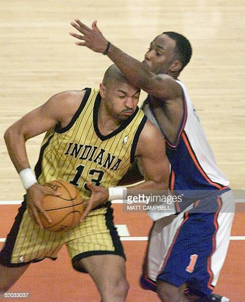 The Indiana Pacers' Mark Jackson drives into the New York Knicks' Chris Childs 07 June during the Eastern Conference Finals at Madison Square Garden...