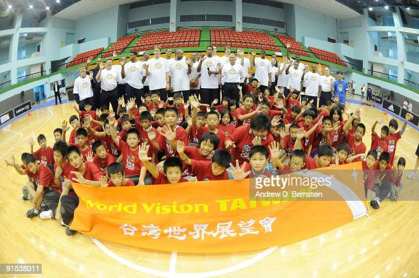 The Indiana Pacers pose with children during an NBA Cares event on October 7 2009 at Taipei Gymnasium in Taipei Taiwan NOTE TO USER User expressly...