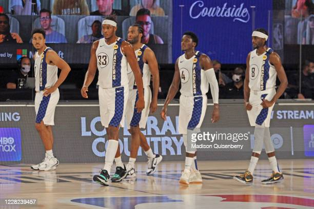 The Indiana Pacers walk off the court against the Miami Heat during Round One, Game Four of the NBA Playoffs on August 24, 2020 at The Field House at...