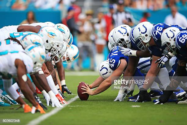 The Indianapolis Colts and Miami Dolphins line up for a snap during the first quarter of the game at Sun Life Stadium on December 27 2015 in Miami...