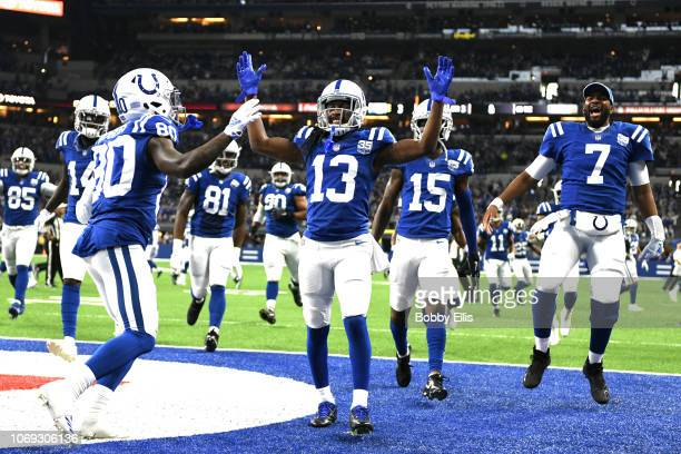 The Indianapolis Colts celebrate after a touchdown in the game against the Tennessee Titans in the third quarter at Lucas Oil Stadium on November 18...