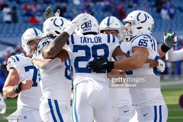 The Indianapolis Colts celebrate after Jonathan Taylor scored a touchdown during the first half of the AFC Wild Card playoff game against the Buffalo...
