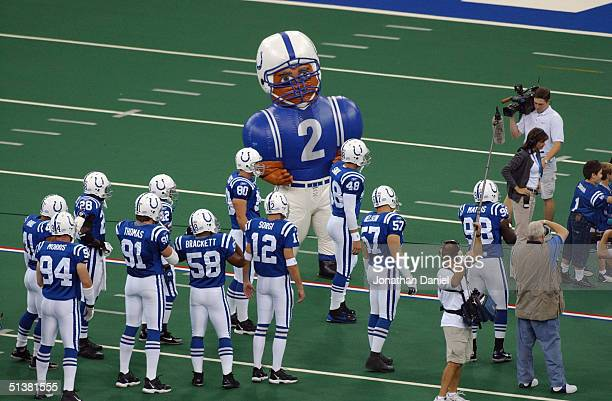 The Indianapolis Colts celebrate with mascot before the game against the Green Bay Packers at the RCA Dome on September 26 2004 in Indianapolis...