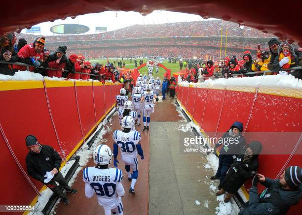 The Indianapolis Colts exit the tunnel onto the field during player introductions prior to the AFC Divisional round playoff game against the Kansas...