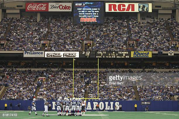 The Indianapolis Colts huddle on the field during the game against the Houston Texans on November 14 2004 at the RCA Dome in Indianapolis Indiana The...