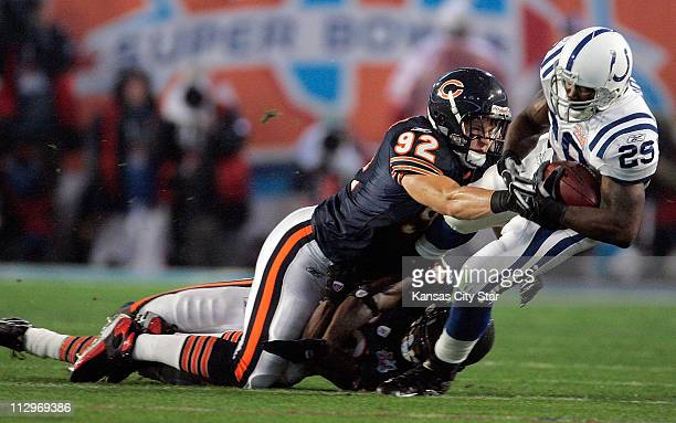 The Indianapolis Colts' Joseph Addai is hit by the Chicago Bears' Hunter Hillenmeyer in the first quarter in Super Bowl XLI in Miami Florida on...