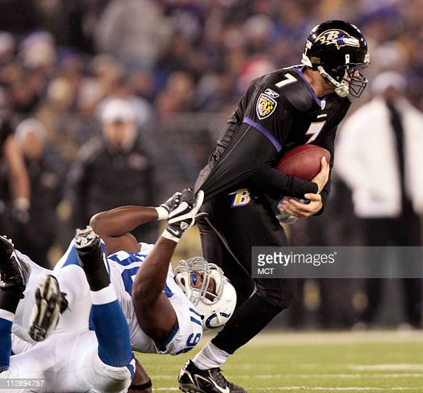 The Indianapolis Colts' Keyunta Dawson keeps a firm grip on Baltimore Ravens' quarterback Kyle Boller in the first half of their game in Baltimore...