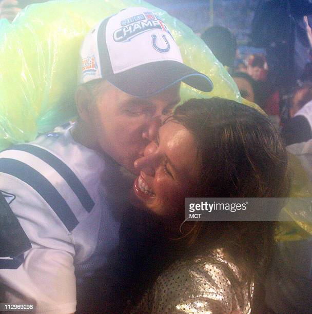 The Indianapolis Colts quarterback Peyton Manning celebrates with his wife after a 2917 victory over the Chicago Bears in Super Bowl XLI in Miami...