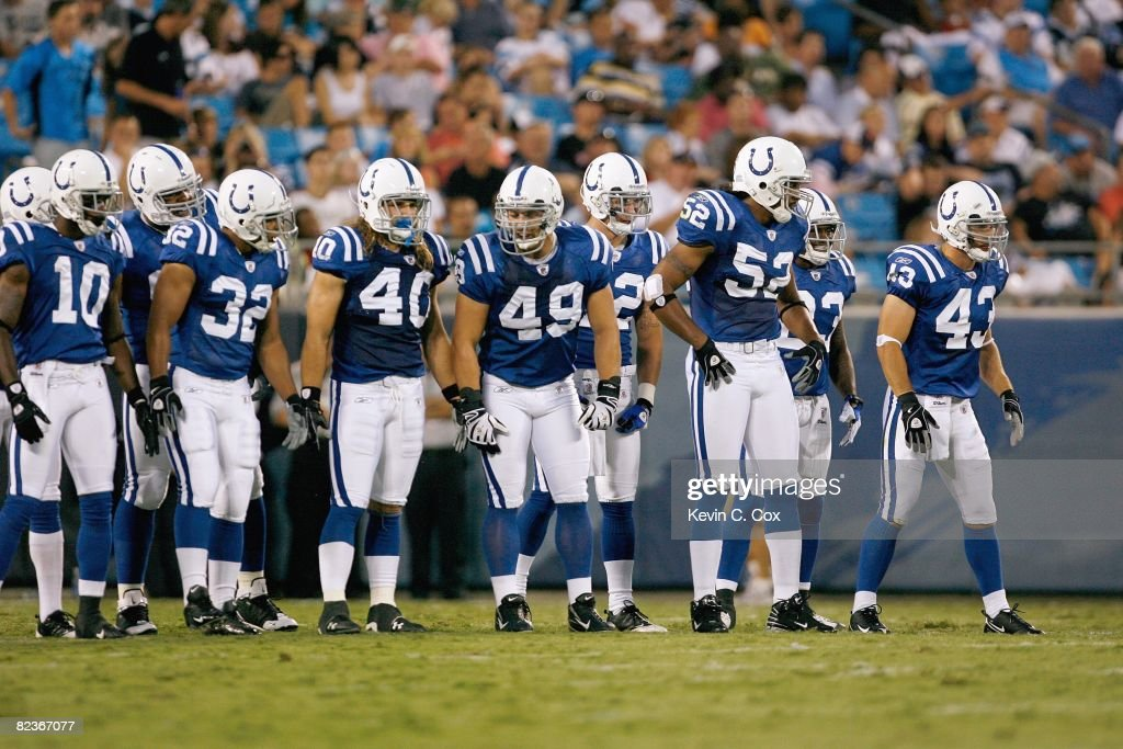 The Indianapolis Colts stand onto the field before the game against the Carolina Panthers at Bank of America Stadium on August, 9, 2008 in Charlotte, North Carolina.
