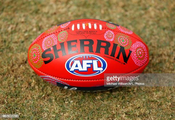 The Indigenous football is seen during the 2018 AFL round 10 match between the Melbourne Demons and the Adelaide Crows at TIO Traeger Park on May 27...