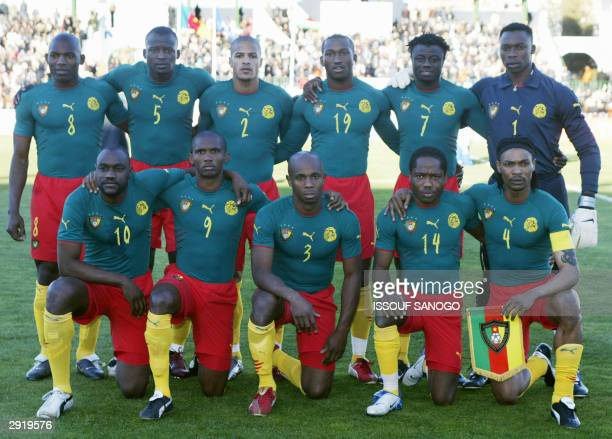 The Indomitable Lions the Cameroon national soccer team pose 29 January 2004 in Sfax stadium prior their match against Zimbabwe during African...