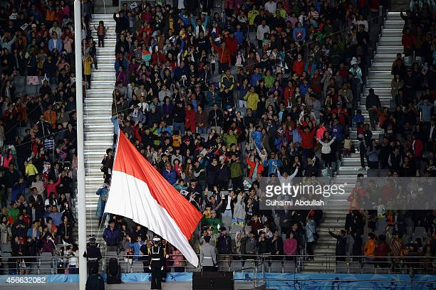 The Indonesia national flag the next host nation for the 18th Asian Games is hoisted during the closing ceremony on day fifteen of the 2014 Asian...