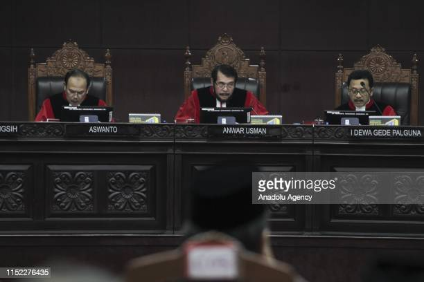 The Indonesian Chief Justice of the Constitutional Court Anwar Usman reads the ruling on 2019 Presidential Election dispute in the Constitutional...