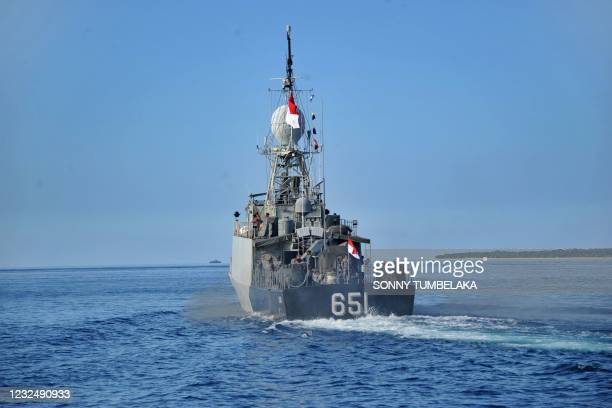 The Indonesian Navy patrol boat KRI Singa leaves the naval base in Banyuwangi, East Java province on April 24 as the military continues search...