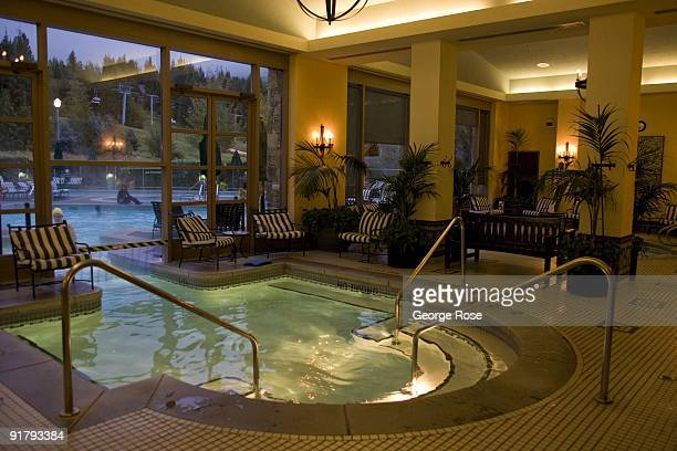 The indoor pool and access to the outdoor pool at the Fairmont Chateau Whistler Hotel is seen in this 2009 Whister British Columbia Canada evening...
