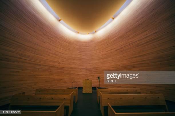 the indoors of famous kamppi chapel in helsinki - 礼拝堂 ストックフォトと画像