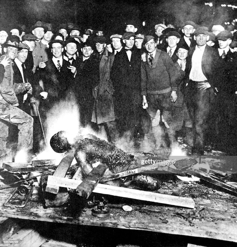 'The Inexpressible' : a group of white men burn a black man alive, 20th, United States.