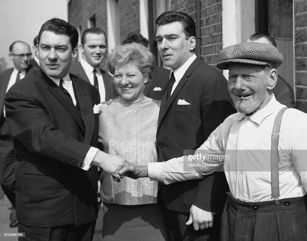 The infamous Kray twin criminals with their mother Violet and their grandfather Jimmy. Seen between the twin on the left and his mother, in the background, is famous London human rights advocate and legal representative George Devlin -- nicknamed 'The Belfast Bruiser' for his aggressive style.