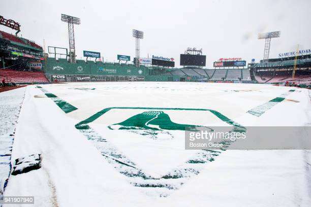 The infield tarp covers the field at Fenway Park during a morning snowfall on April 2 three days before the Boston Red Sox home opener