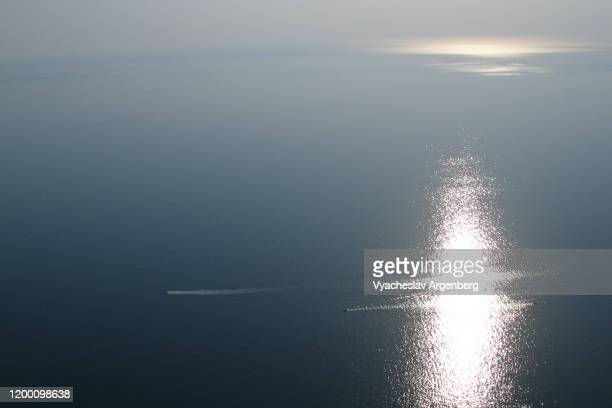 the infinity of black sea, reflections of sunlight in the sea, sea panorama, summer in crimea - argenberg stock pictures, royalty-free photos & images