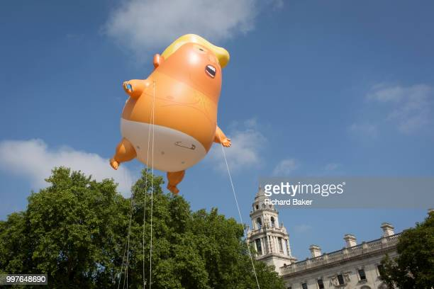 The inflatable balloon called Baby Trump flies above Parliament Square in Westminster the seat of the UK Parliament during the US President's visit...