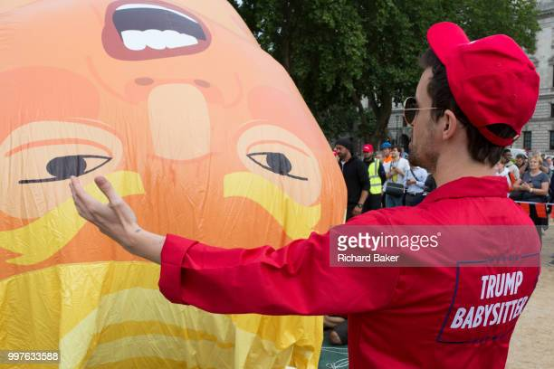The inflatable balloon called Baby Trump is almost readt to fly above Parliament Square in Westminster the seat of the UK Parliament during the US...