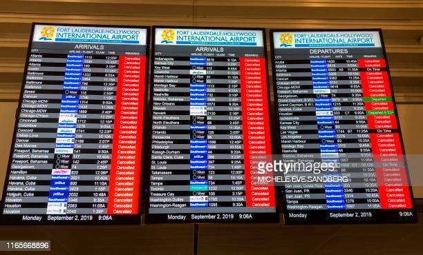 The information board displays all the cancelled flights at the Fort Lauderdale International airport ahead of the arrival of hurricane Dorian at...