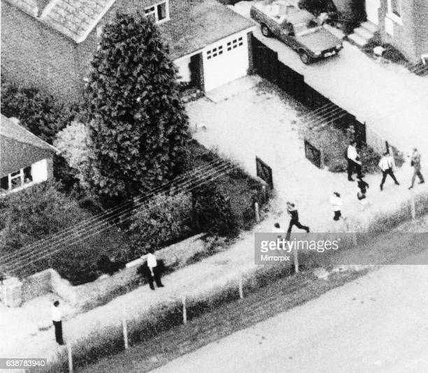 The inhabitants of Hungerford fleeing in distress past the house of the mother of gunman Michael Ryan who fled from there into the town centre to...