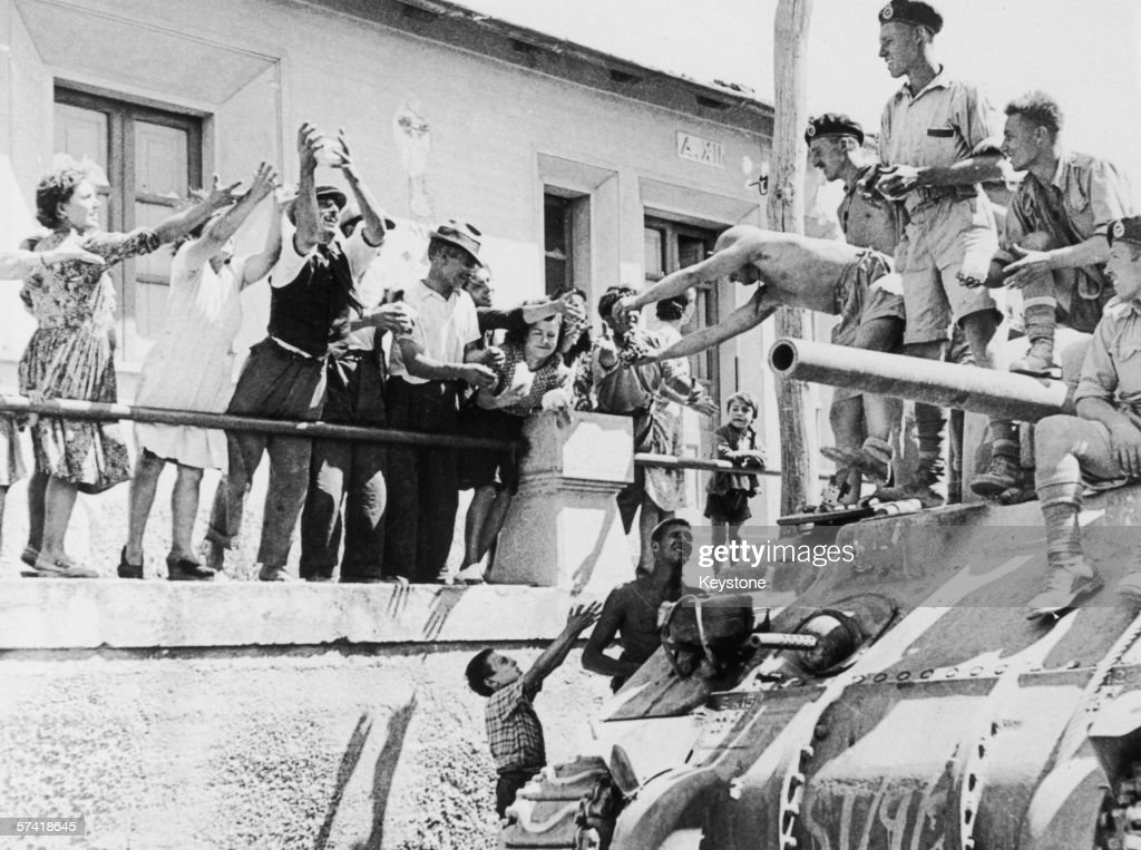 The inhabitants of Reggio cheer the arrival of an Allied tank during the Allies' invasion of Italy, September 1943.