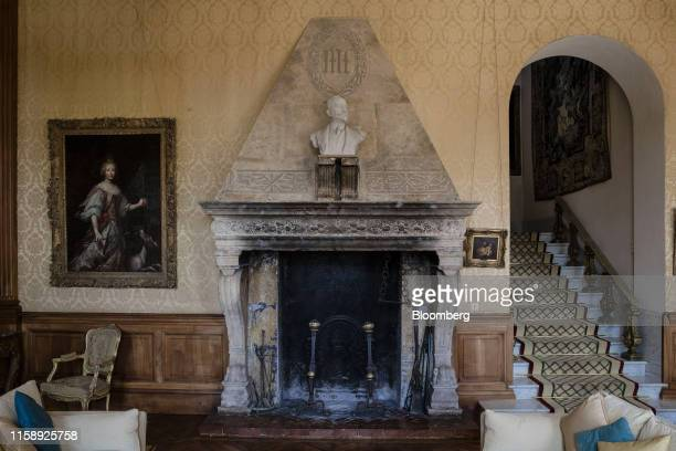 The initials ML for the MarnierLapostolle family sit inscribed on a stonework of a fireplace inside the Villa Les Cedres a 187yearold000squarefoot...