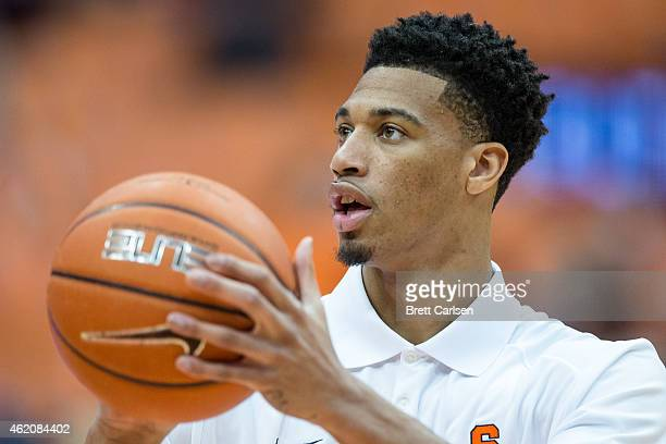 The injured Chris McCullough of the Syracuse Orange shoots the ball in street clothes before the game against the Miami Hurricanes on January 24 2015...