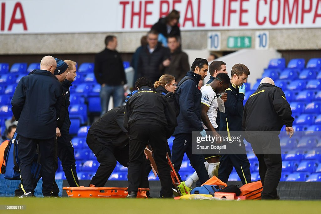 The injured Danny Rose of Spurs is helped from the pitch during the Barclays Premier League match between Tottenham Hotspur and Stoke City at White Hart Lane on November 9, 2014 in London, England.