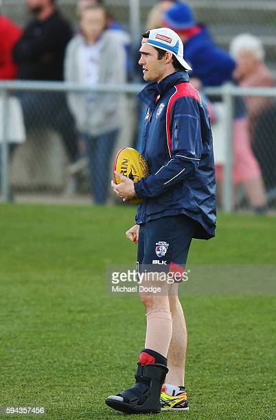 The injured Easton Wood of the Bulldogs looks upfield during a Western Bulldogs AFL training session at Whitten Oval on August 23, 2016 in Melbourne,...