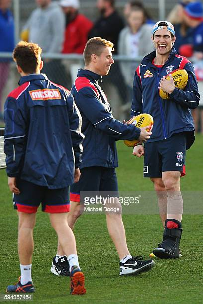 The injured Easton Wood of the Bulldogs reacts to Lachie Hunter during a Western Bulldogs AFL training session at Whitten Oval on August 23, 2016 in...