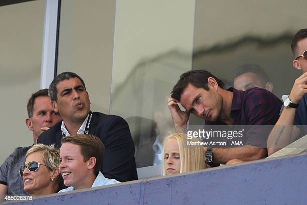 The injured Frank Lampard of New York City FC siting next to Director of football operations Claudio Reyna watches the MLS match between Los Angeles...