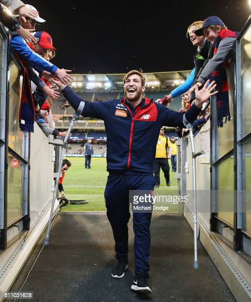 The injured Jack Viney of the Demons celebrates the win with fans during the round 16 AFL match between the Carlton Blues and the Melbourne Demons at...