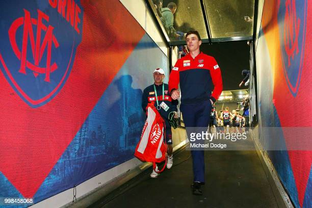 The injured Jake Lever of the Demons walks off after winning during the round 17 AFL match between the Melbourne Demons and the Western Bulldogs at...