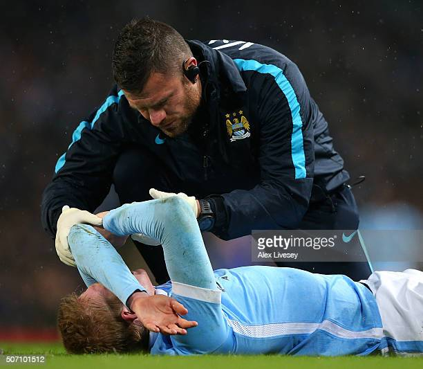 The injured Kevin De Bruyne of Manchester City receives medical treatment during the Capital One Cup Semi Final second leg match between Manchester...