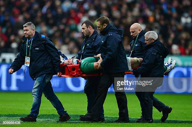 The injured Mike McCarthy of Ireland is stretechered off the pitch during the RBS Six Nations match between France and Ireland at the Stade de France...
